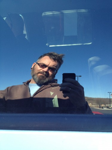 12:44 PM: Truck reflection selfie, in the Lowe's parking lot.