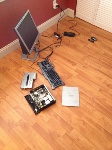 3:10 PM: Repairing one of the tattoo studio's computers. It seems some things never change....