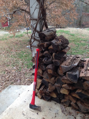 10:49 AM: The wood pile. Well, the one on the side porch. Time to refill it from the big pile. That will give the Husbear something to do this weekend...