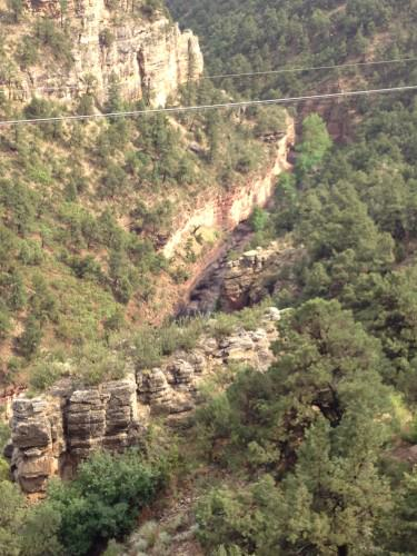 The canyon below has a massive flash flood roaring through it...