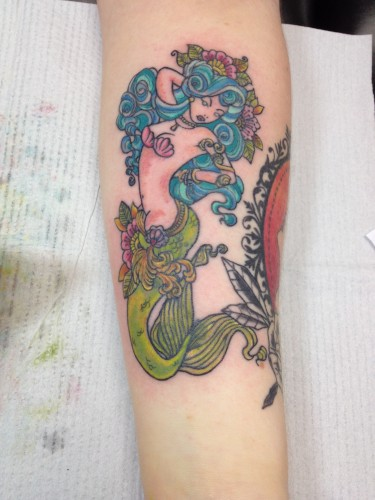 3:30 PM: Finished tattoo. Once she heals, her flesh colors will look less... red.