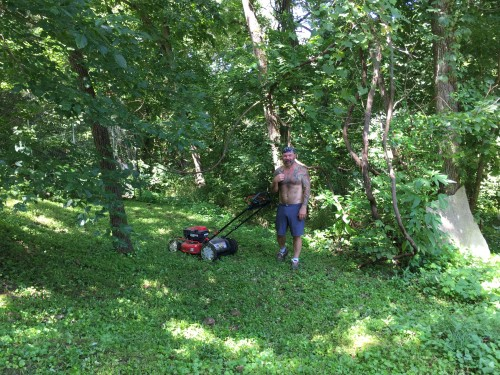 10:57 AM: The Husbear, mowing the lawn. It's a two day affair.