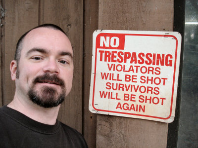 Erik with no trespassing sign