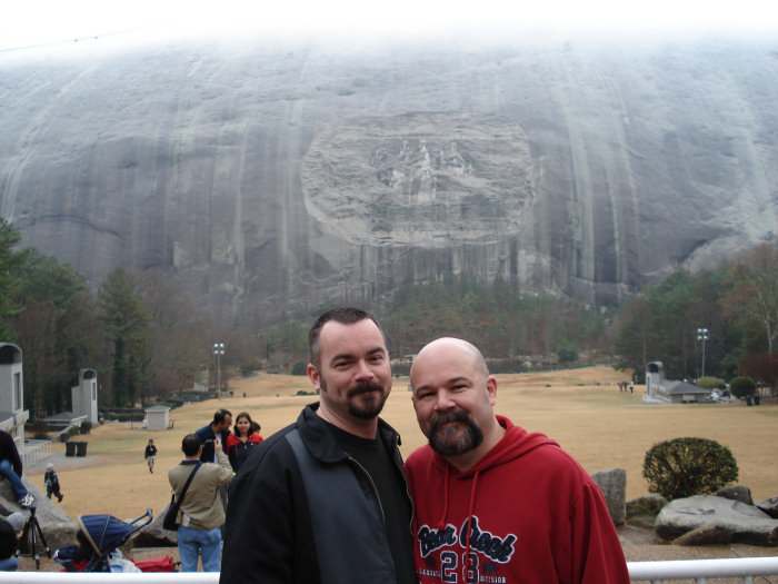 the Husbear and Erik in front of the carving on Stone Mountain.